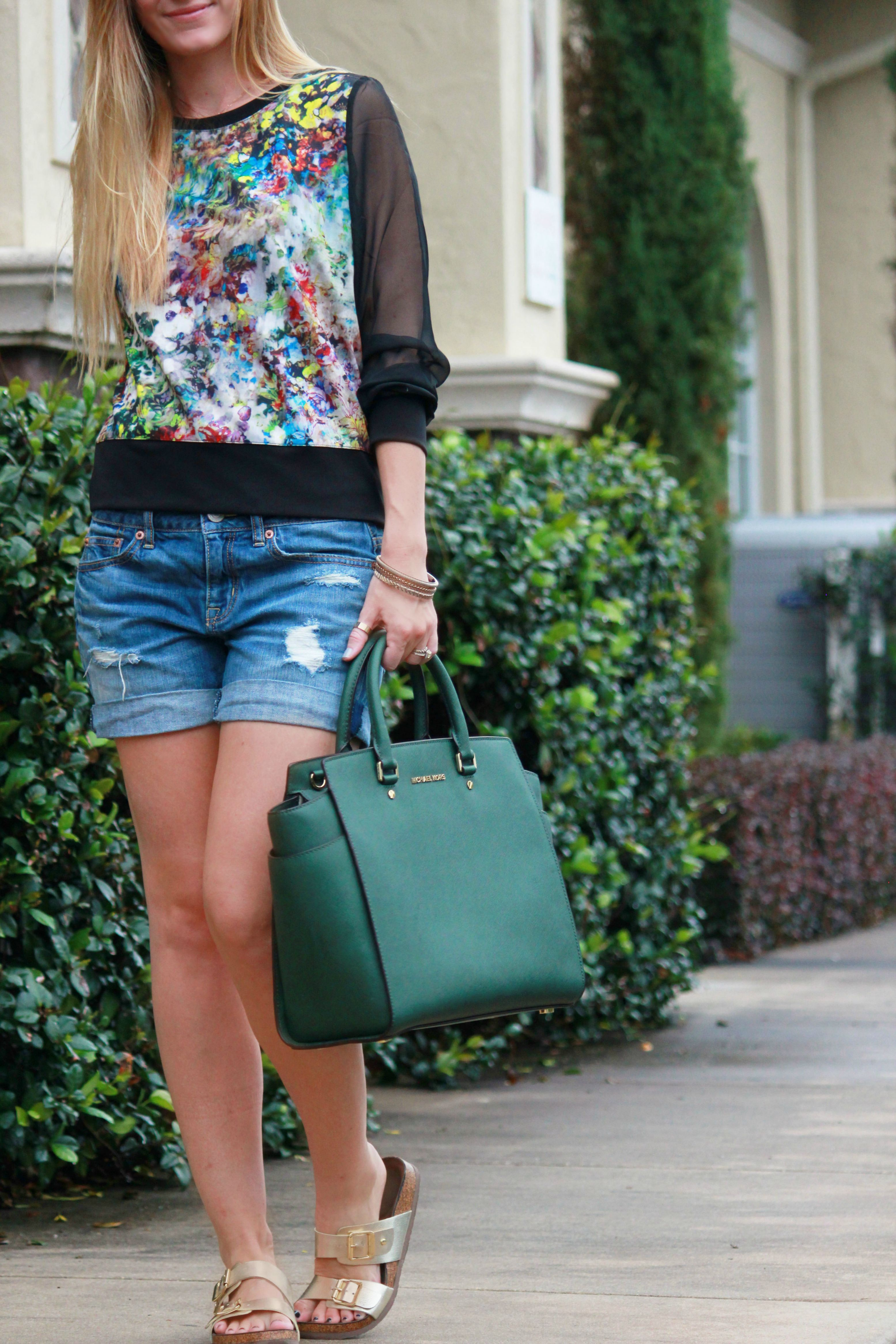 sheer sleeved blouse paired with boyfriend jeans, selma michael kors bag, and birkinstocks