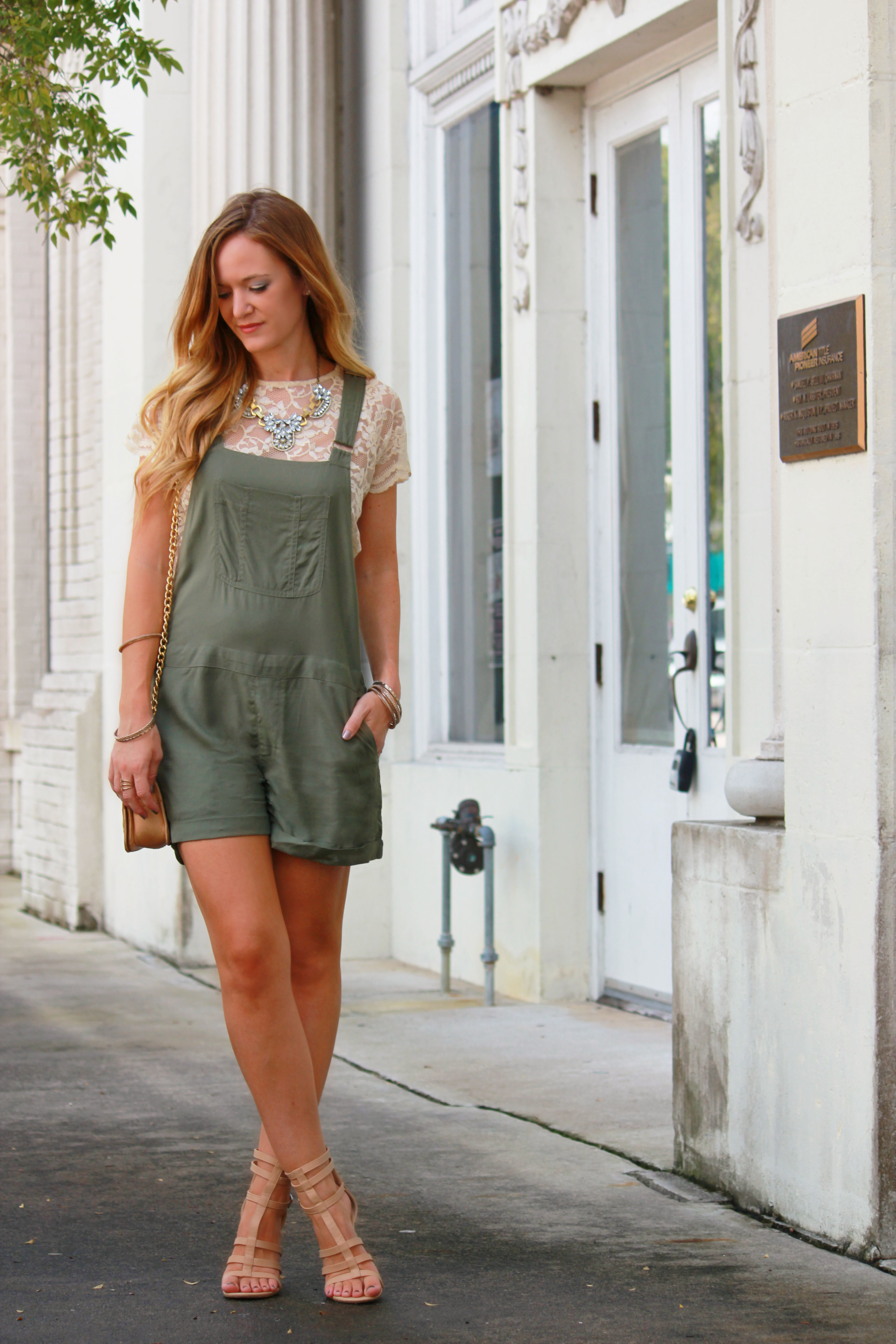 american eagle overalls, green overalls, fall transition outfit, badgley mischka bag, glaiator sandals, lace crop top, casual fall outfit