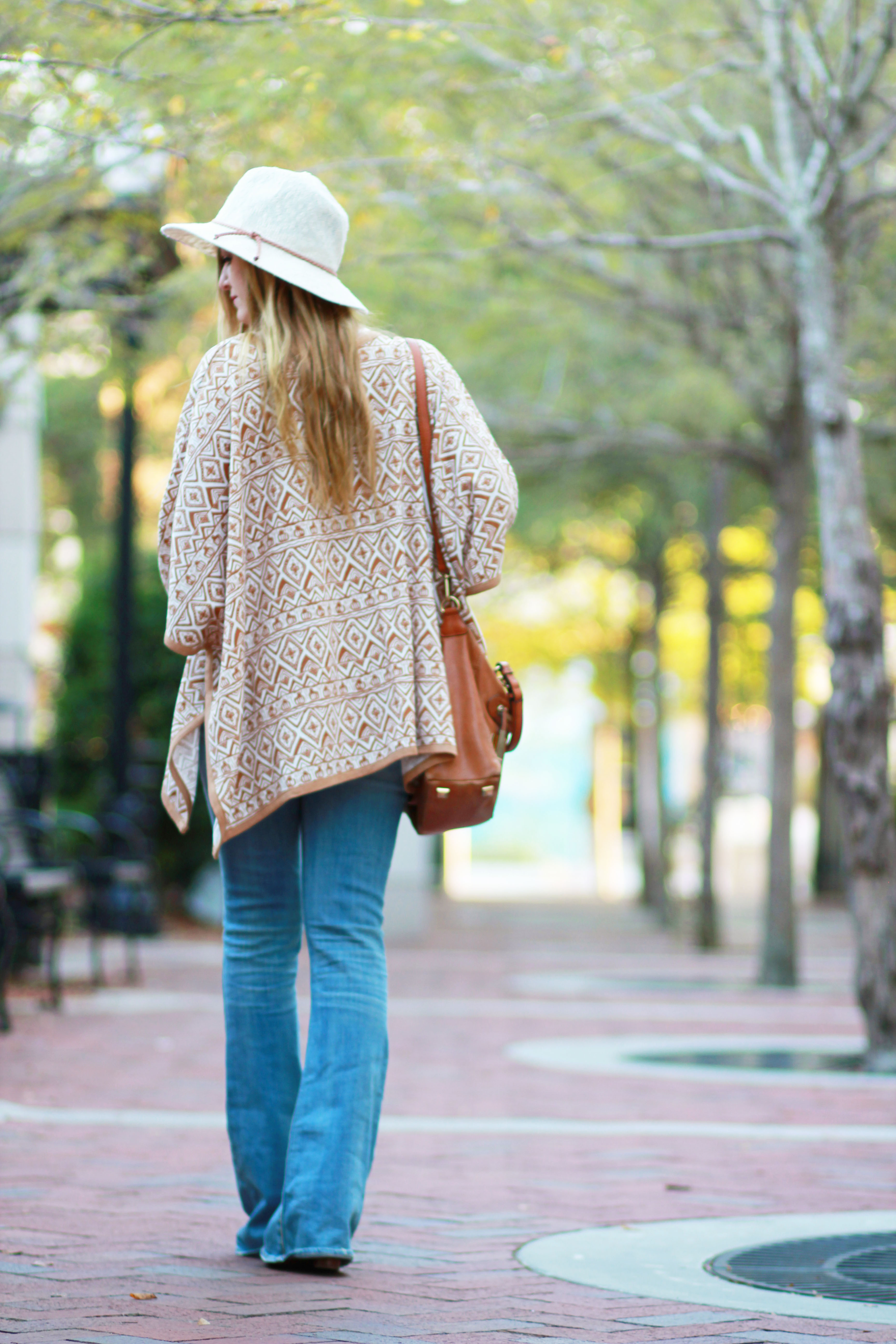 florida fashion blogger styles sugar love boutique tribal cardigan with american eagle flared jeans, Michael kors purse, and dsw booties for a boho chic outfit