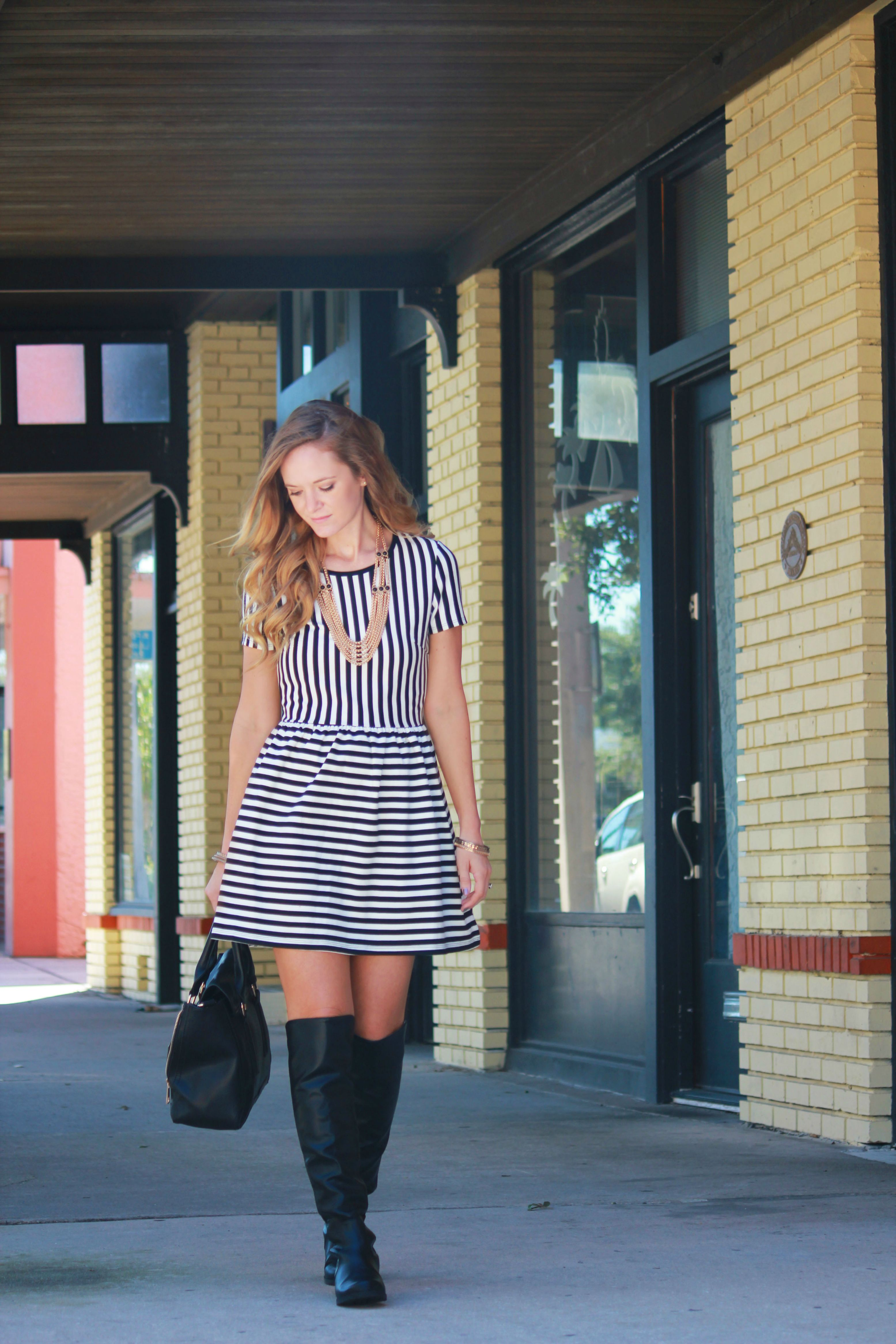 orlando/ florida fashion blogger styling forever 21 striped dress, dsw over the knee boots, and forever 21 black and gold necklace for a casual fall outfit