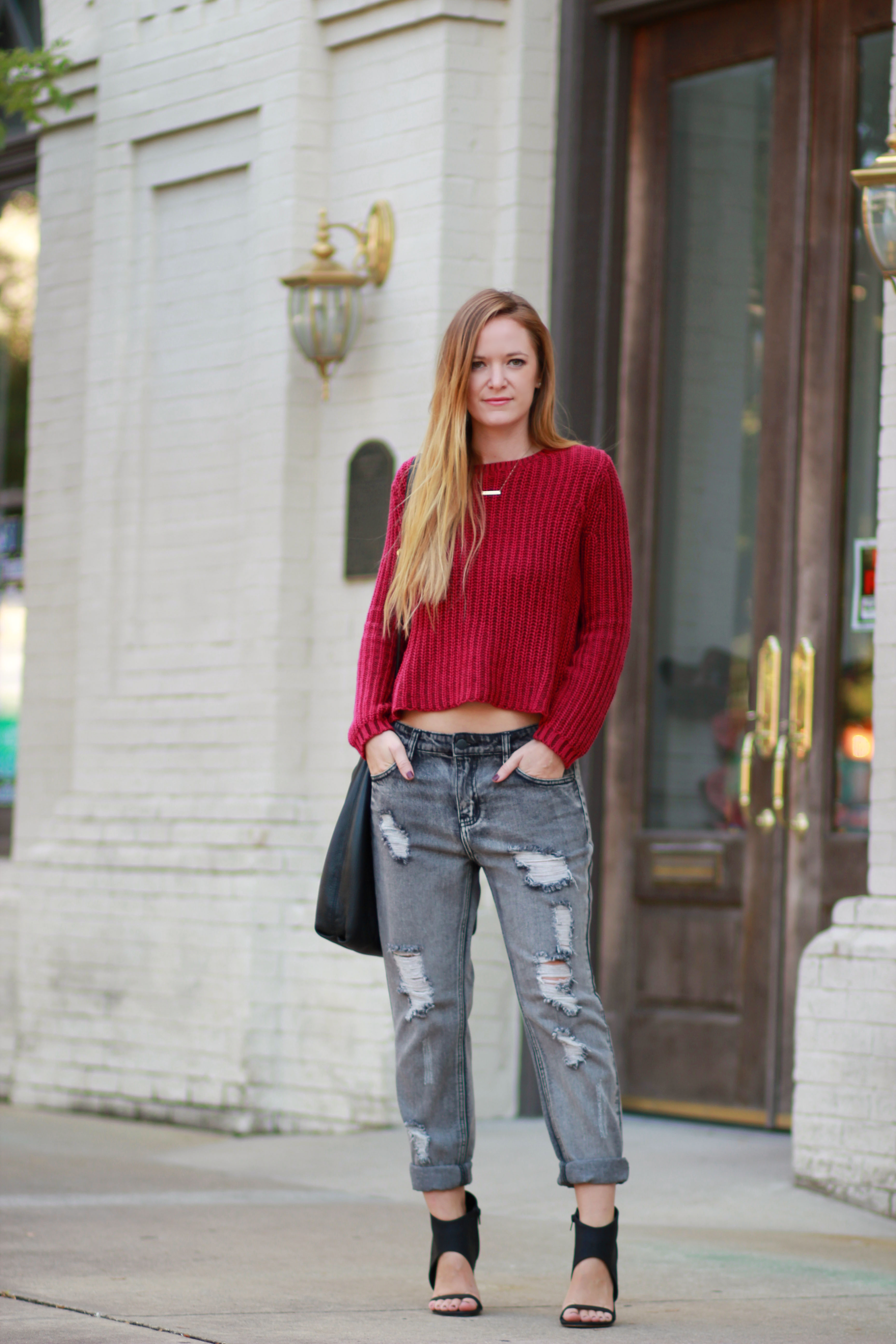 florida fashion blogger styles aeropostale crop top, forever 21 boyfriend jeans, and michael kors bag  for a casual fall outfit