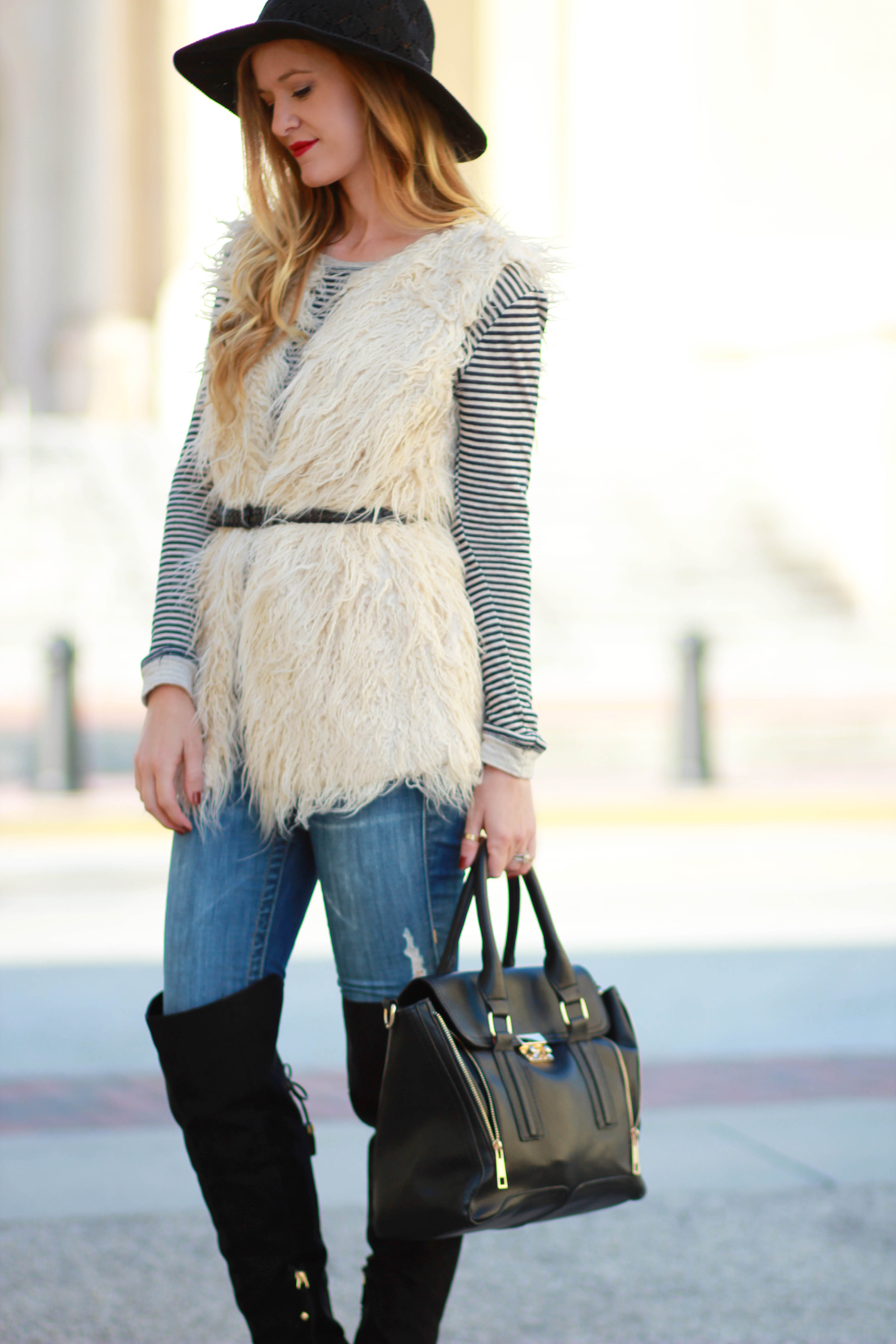 orlando/ florida fashion blogger styles sugar love boutique fur vest with true religion jeans and target over the knee boots for a fall outfit