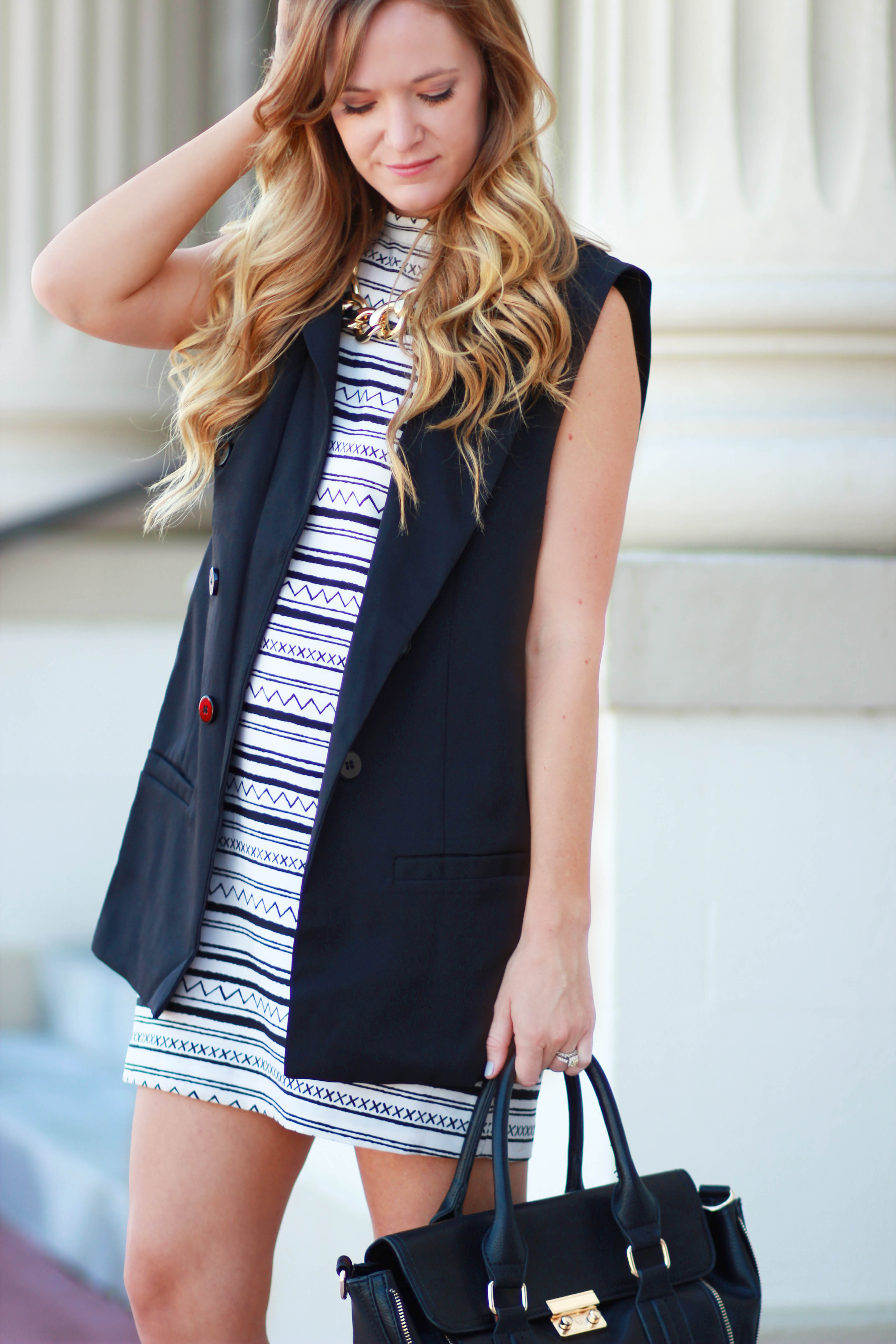 florida fashion blogger stypes black and white shift dress with oasap vest, h&m booties, mint and lolly necklace for a casual fall outfit