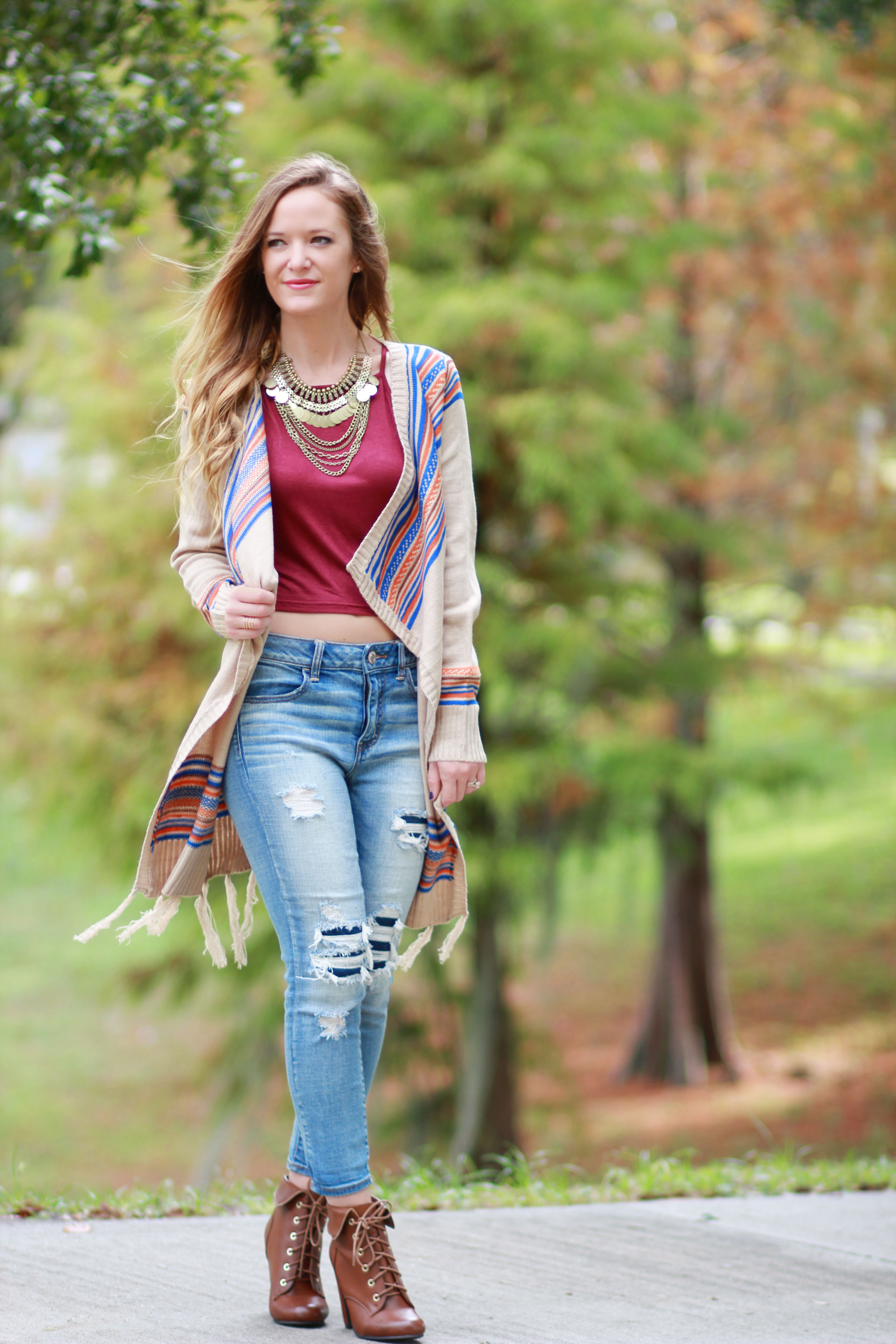 florida, orlando fashion blogger styles hippie chick boutique fringe cardigan, american eagle distressed jeans, blush boutique crop top and sugar pair booties for a casual fall outfit