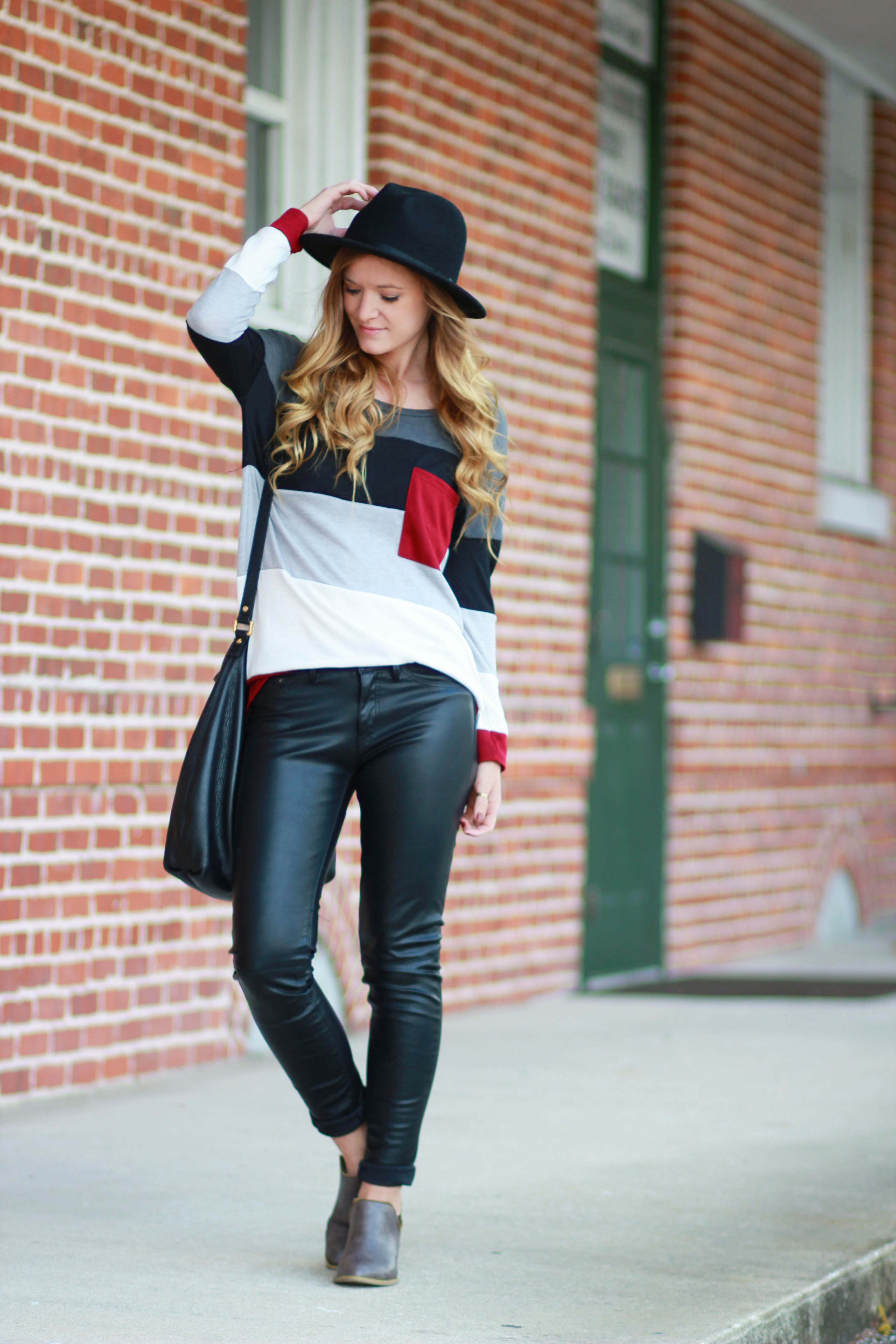 florida, orlando fashion blogger styles hippie chick boutique striped top and h&m leather pants with target fedora and forever 21 booties for a casual fall outfit