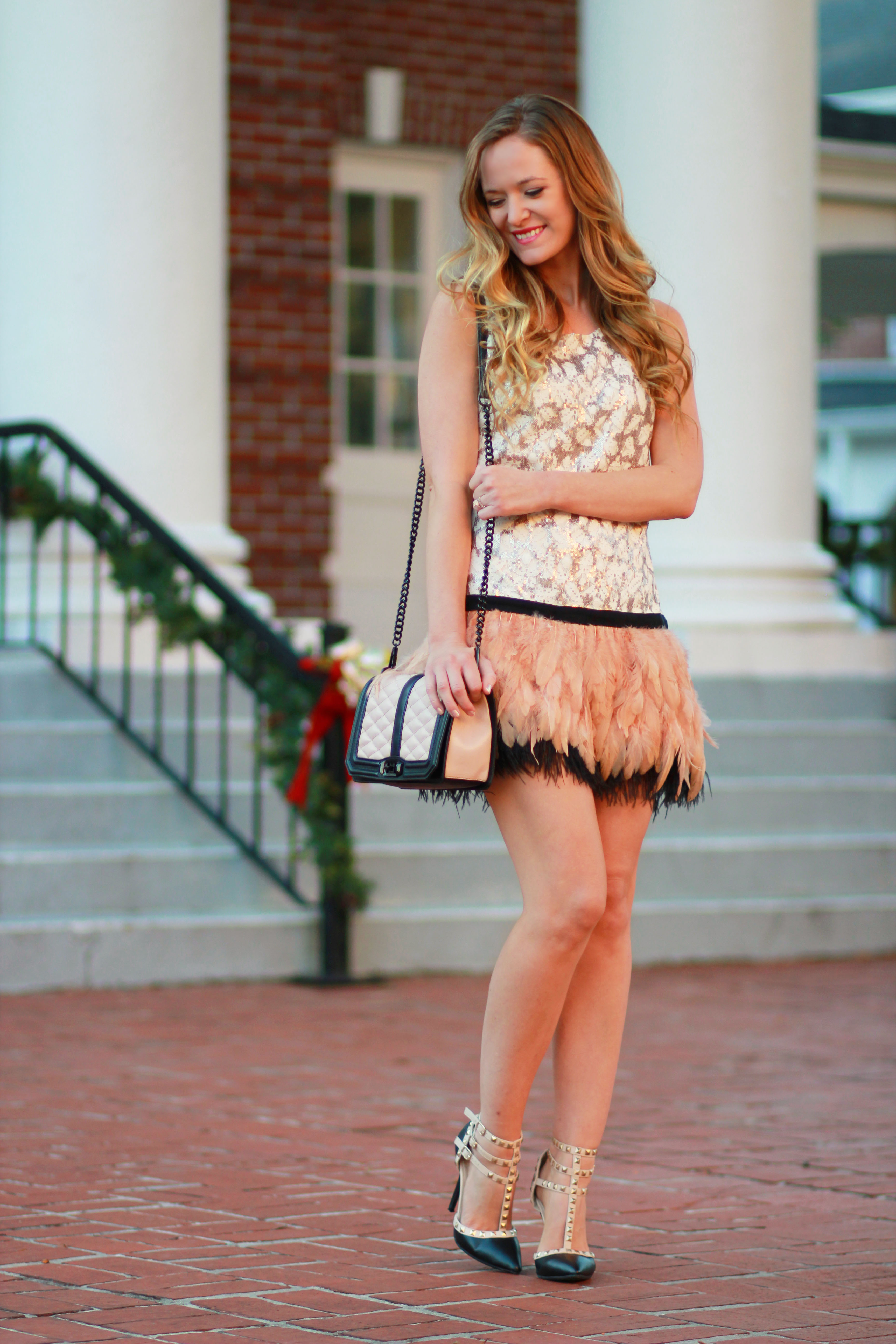 orlando, florida fashion blogger styles new years eve white plum dress with sequin and feather details and rebecca minkhoff crossbody