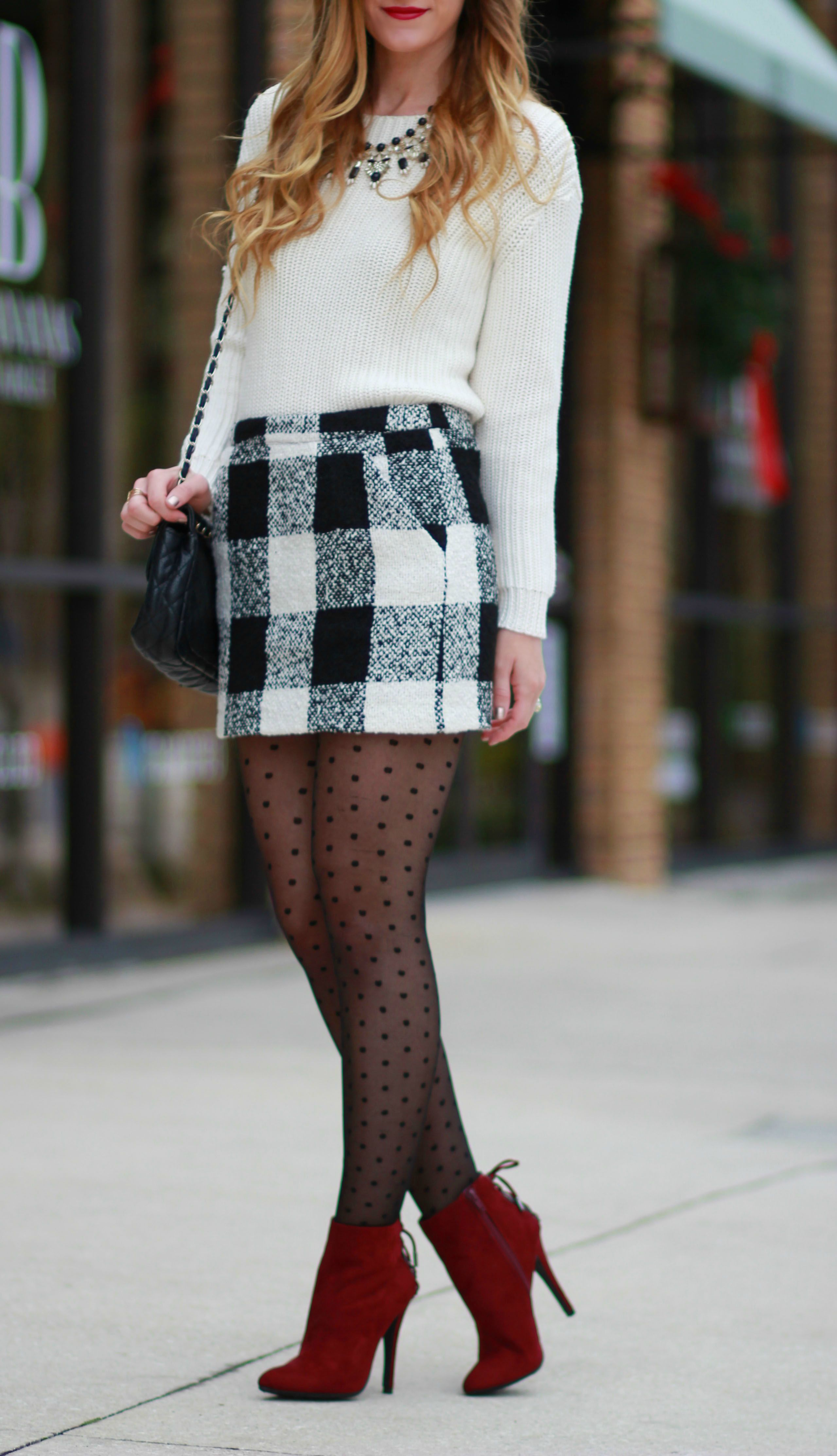 florida, orlando fashion blogger style forever 21 buffalo check, h&m sweater, black and white statement necklace, polka dotted tights, and sugar pair booties for a holiday outfit