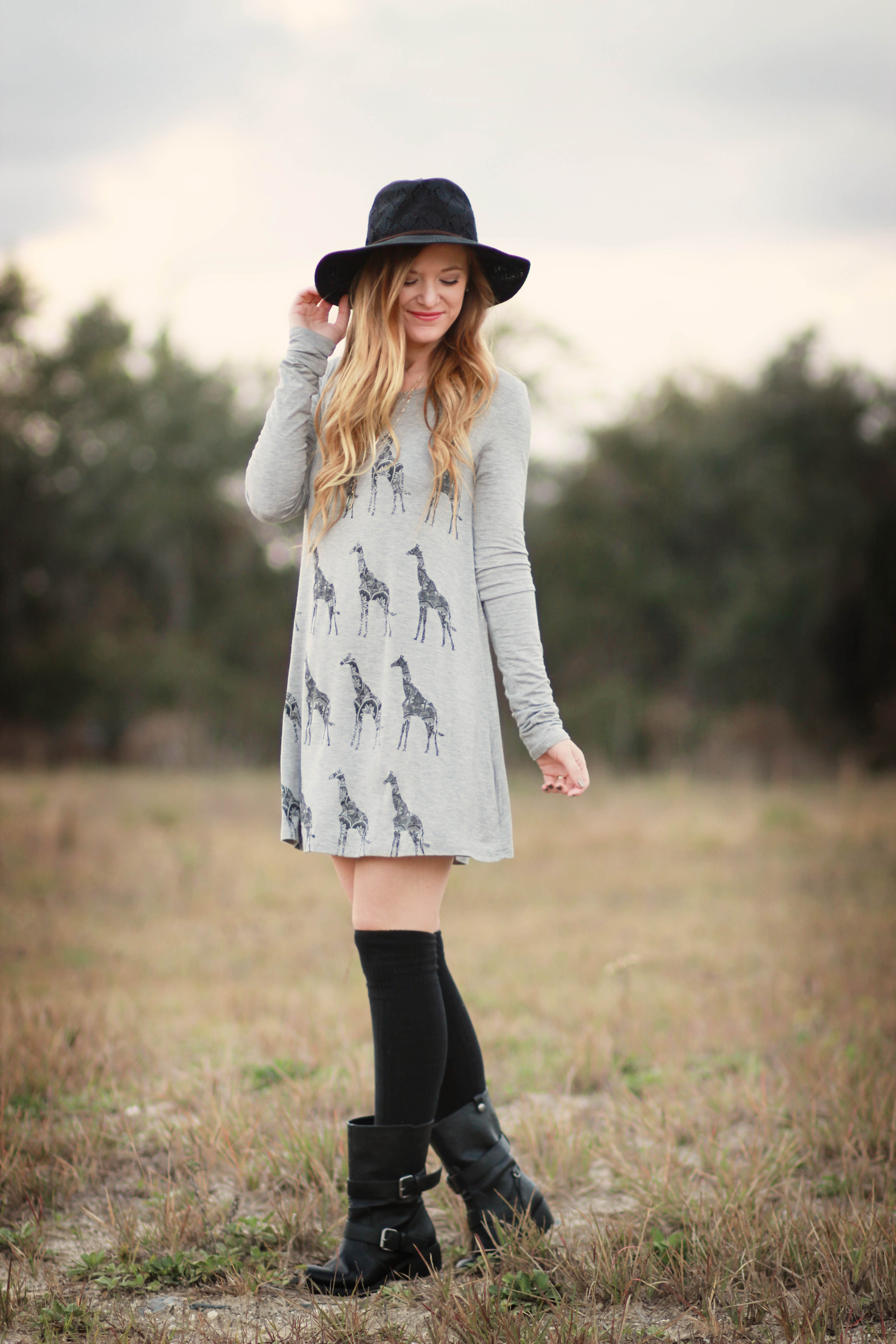 orlando, florida style blogger styles giraffe dress with free people hat, combat boots and knee socks for a casual boho outfit