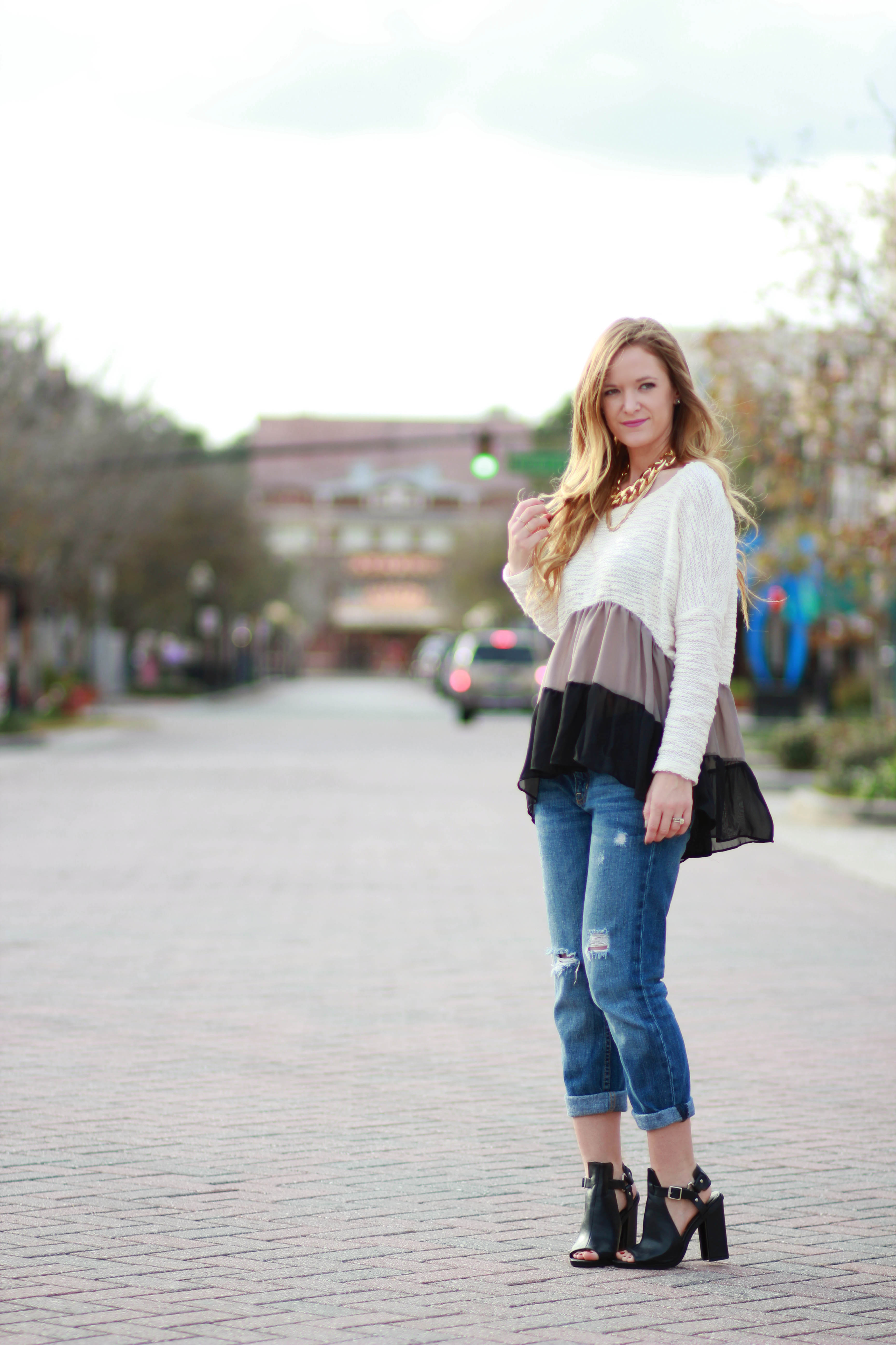 orlando, florida fashion blogger styles trunk up ruffled sweater with american eagle boyfriend jeans and windsor booties for a casual winter outfit