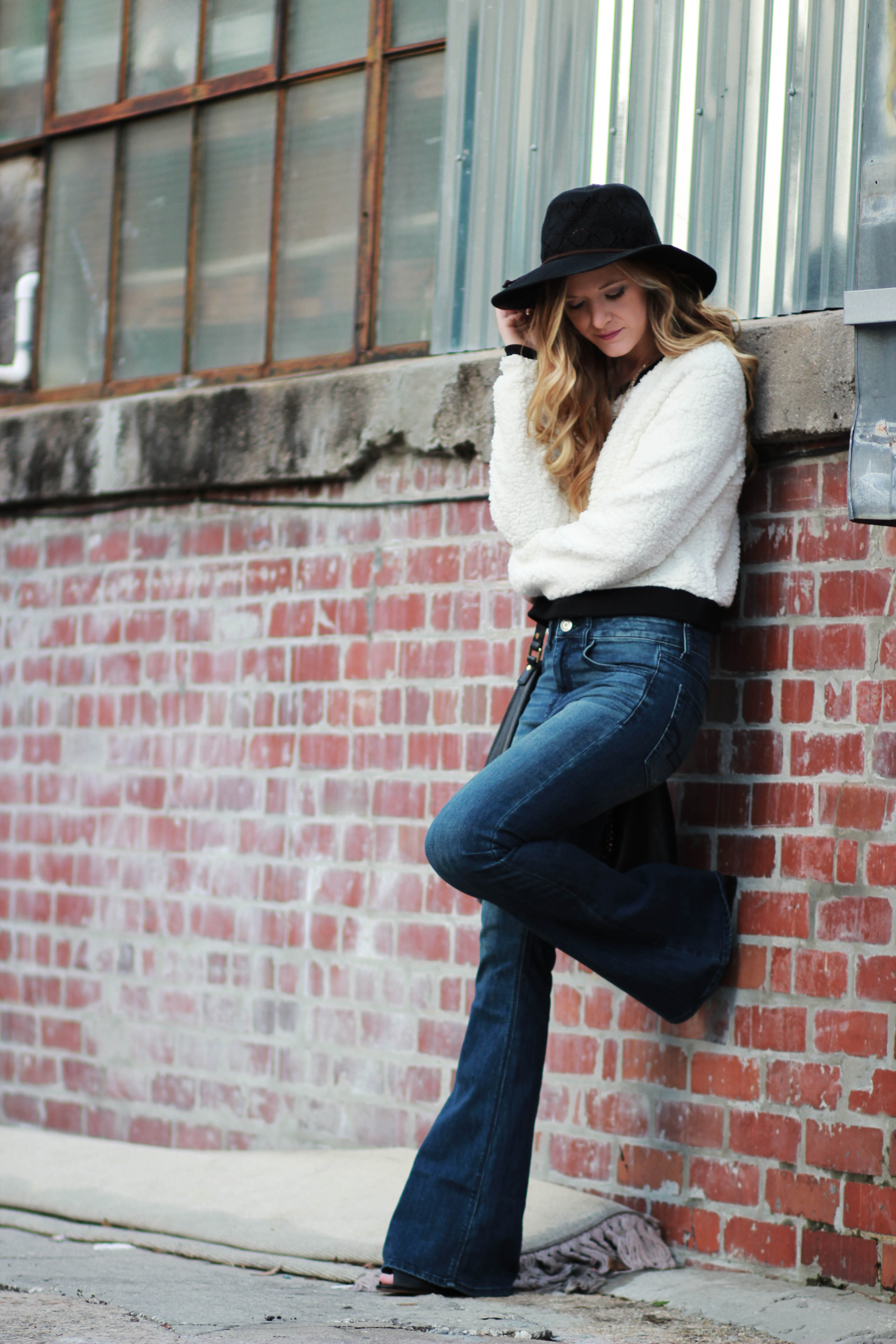 orlando, florida fashion blog styles aeropostale sweater, american eagle, flared jeans, free people hat, and michael kors bag for a casual winter outfit