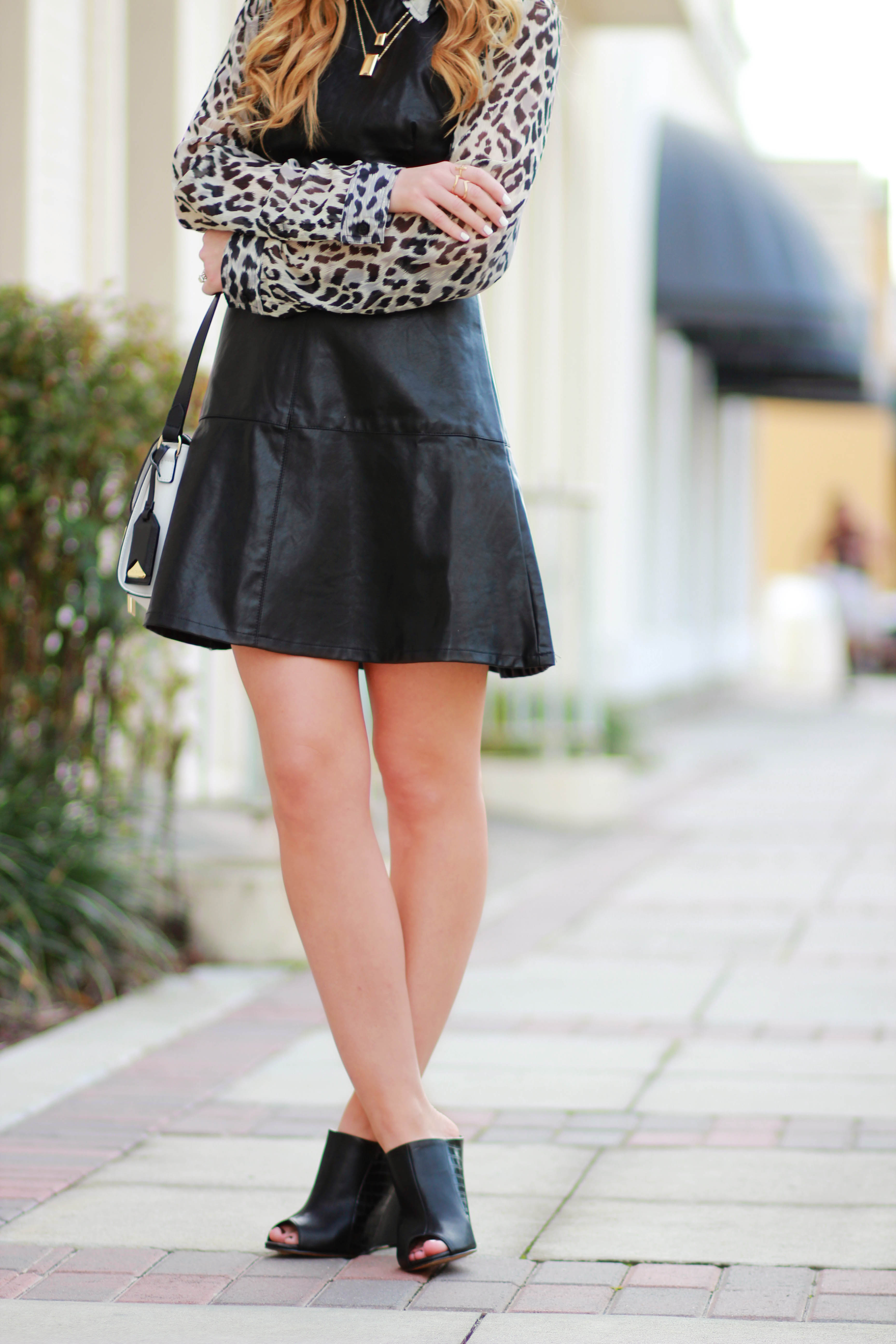 orlando, florida fashion blogger styles forever 21 leather dress and leopard blouse with vince camuto crossbody bag for a casual winter outfit
