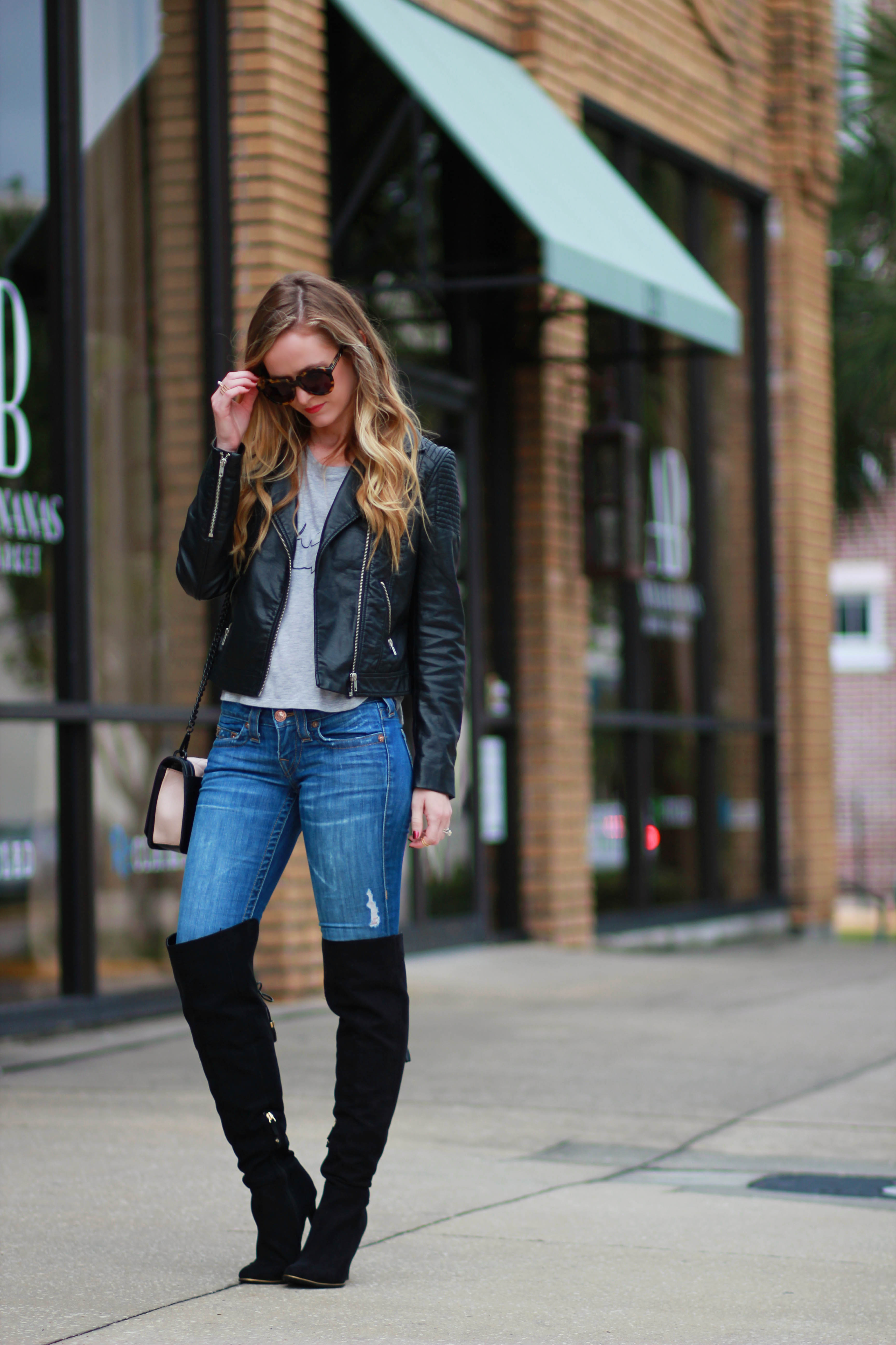 orlando, florida fashion blogger styles elle b top with h&m leather jacket, target over the knee boots, and karen walker sunglasses for a winter outfit