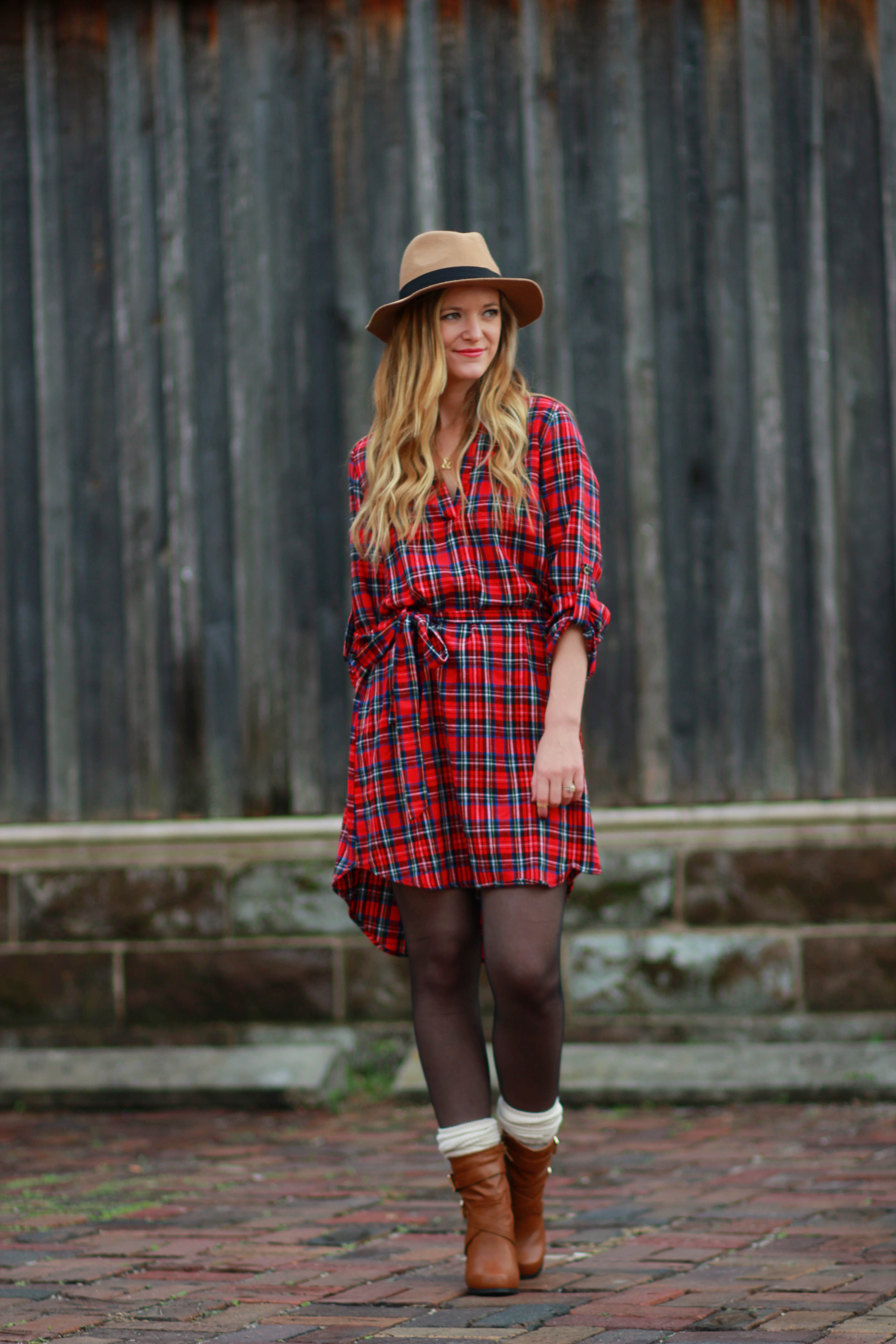orlando, florida fashion blogger styles cheeky peach plaid dress, brown booties with socks for a casual winter outfit