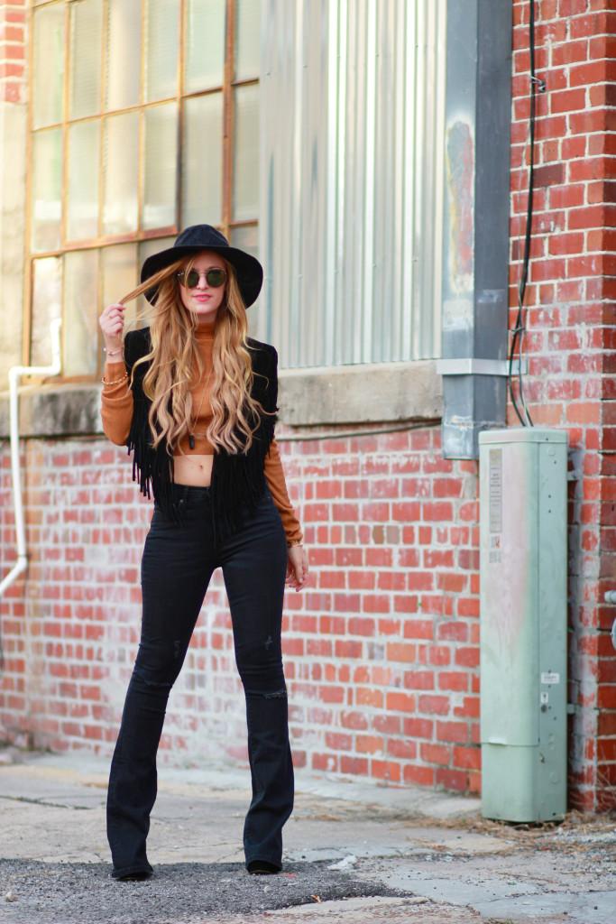 asos fringe cape, gap flared jeans, ray ban round sunglasses