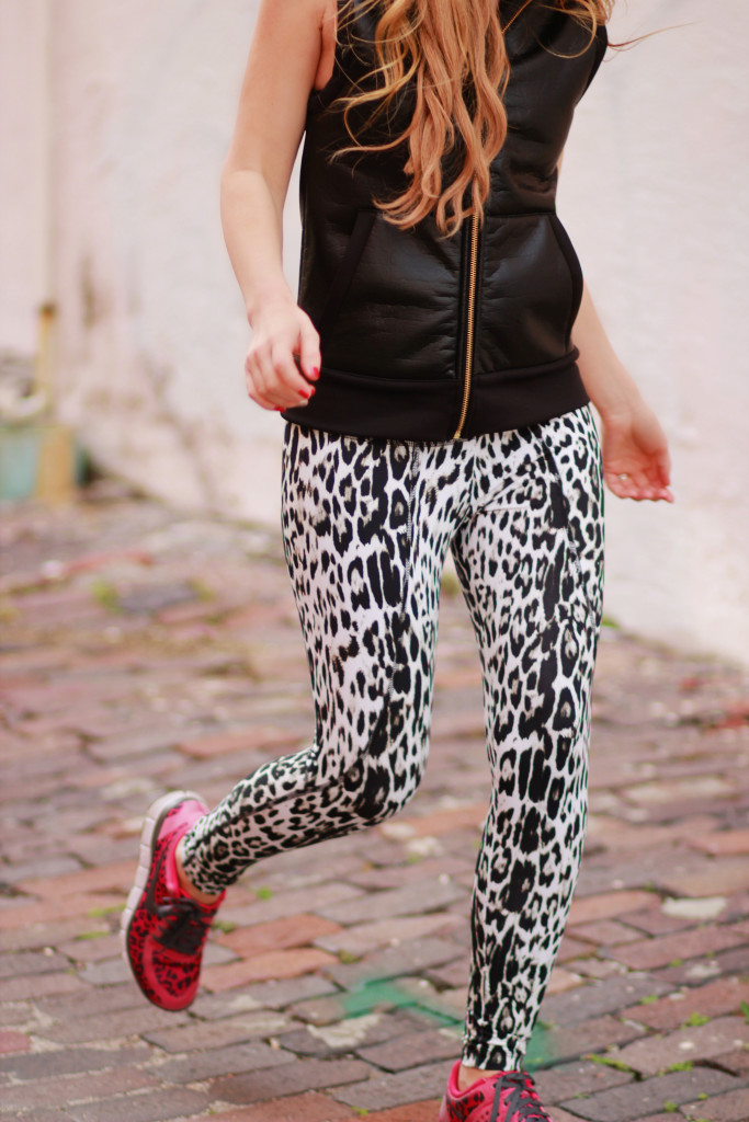Carbon 38 leather vest, leopard workout leggings, and leopard nike free