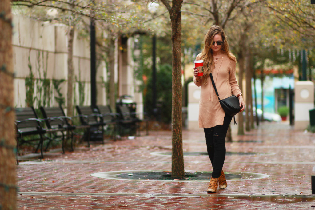 Shein lace up sweater with DSTLD black distressed jeans, Matisse nugent booties, and Rebecca Minkoff unlined saddle bag