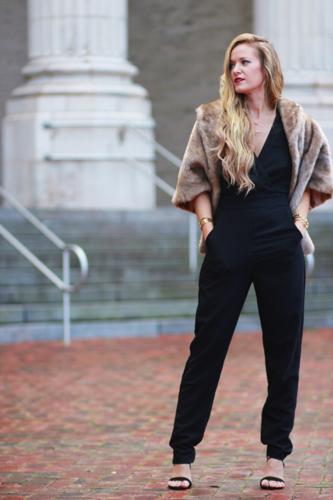 Black WAYF jumpsuit and fur shrug