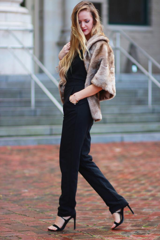 Black WAYF jumpsuit and fur shrug