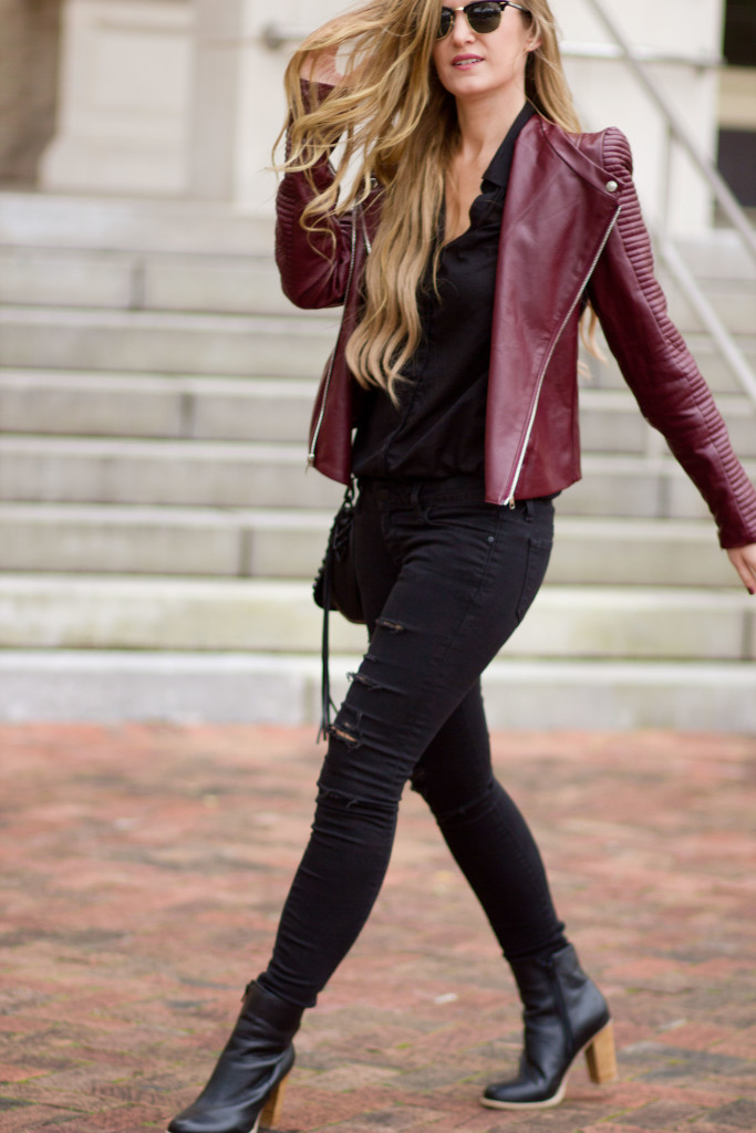 Burgundy leather jacket, black distressed jeans, Ray Ban Clubmasters, and Rebecca Minkoff saddle bag