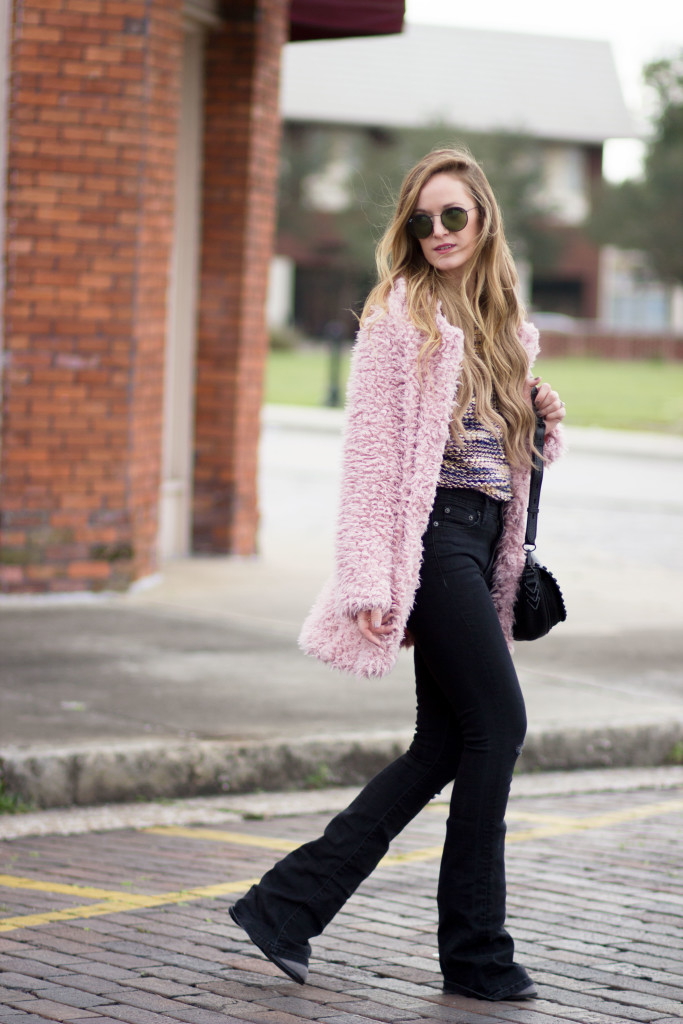 Pink fur coat, Gap black flared jeans, Rebecca Minkoff saddle bag and Ray Ban round sunglasses