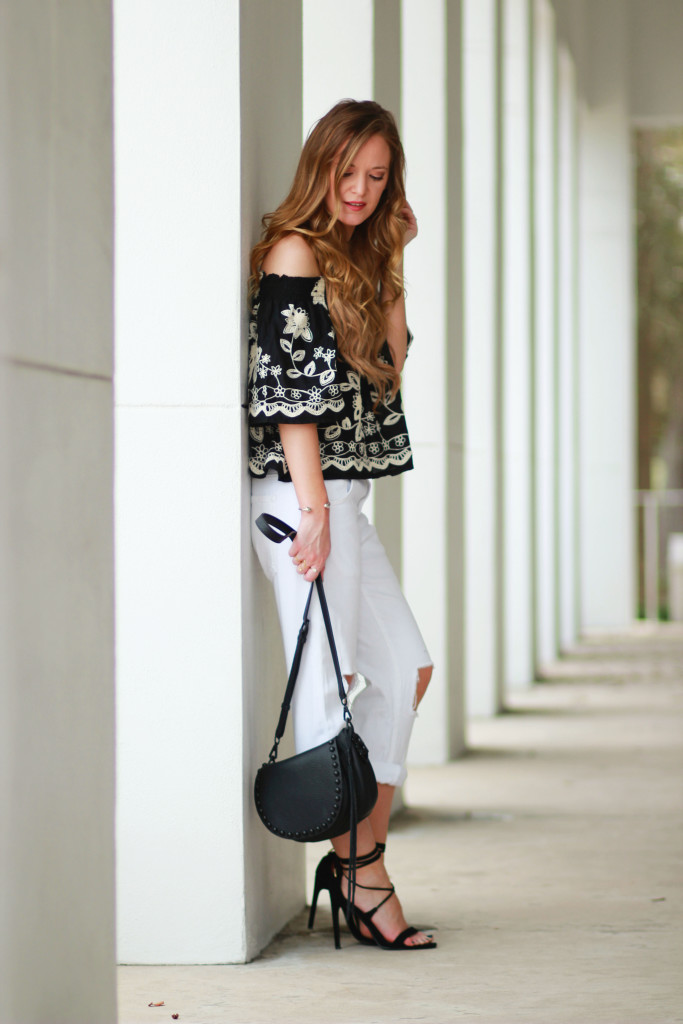 Orlando Florida fashion blogger styles ASOS boho top with DSTLD distressed boyfriend jeans, Rebecca Minkoff saddle bag for a casual spring outfit
