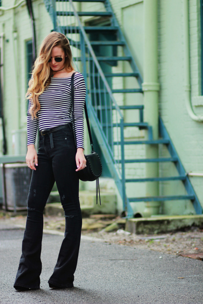 Orlando Florida fashion blogger styles Hollister off the shoulder top, Gap flared black jeans, Rebecca Minkoff saddle bag for an edgy spring outfit