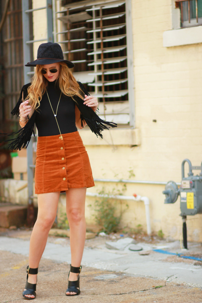 Orlando Florida fashion blog styles Madison & Berkely bodysuit with corduroy button up skirt, black fringe vest, round Ray Ban sunglasses for a boho outfit