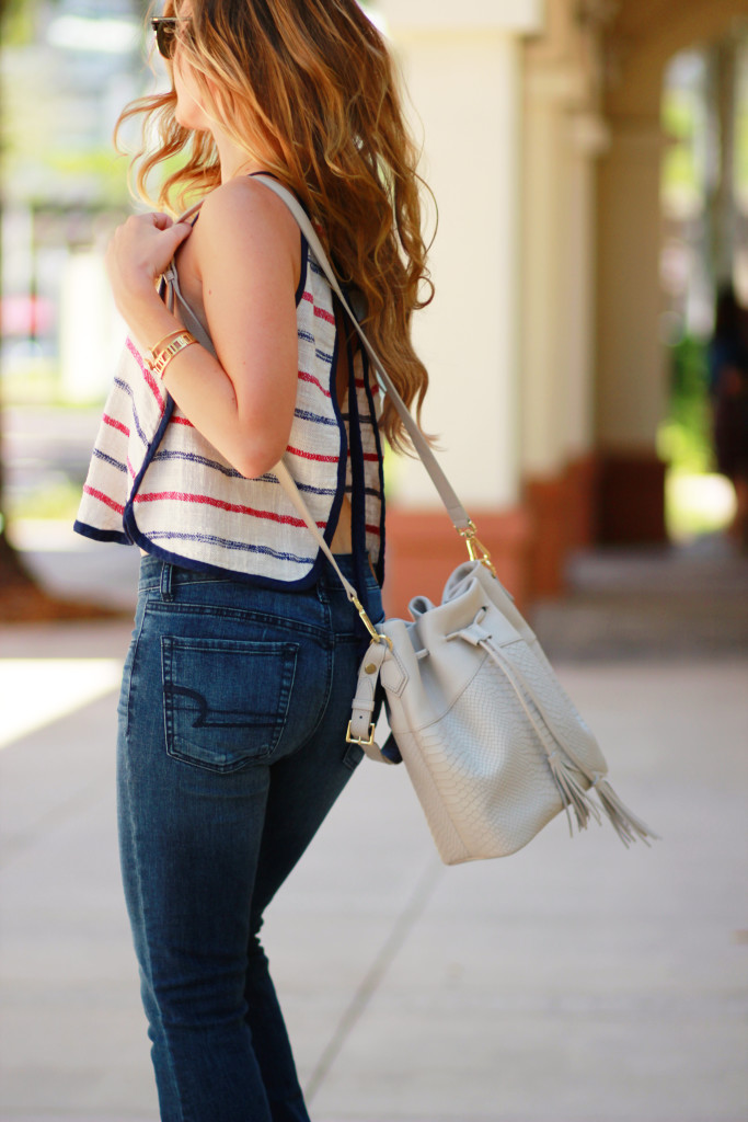 Orlando Florida fashion blog styles Free People crop top with American Eagle flared jeans, GiGi New York bucket bag, Ray Ban clubmaster for casual outfit