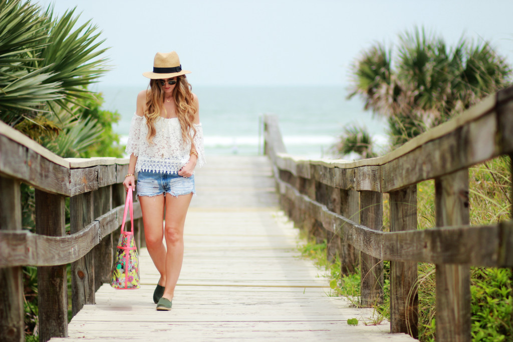 Orlando Florida fashion blog styles lace off the shoulder top with high waisted distressed jean shorts, Ray Ban round glasses for a vacation outfit