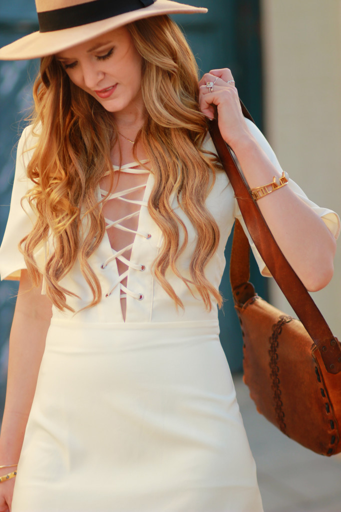 Orlando Florida fashion blog styles Tobi cream lace up dress with Matisse nugent booties, tan felt hat, and leather saddle bag for a casual spring outfit