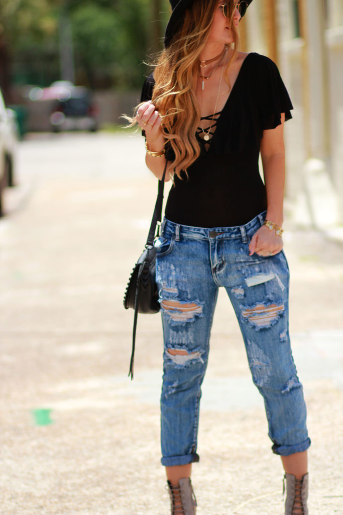 Orlando Florida fashion blog styles lace up bodysuit with Tobi distressed boyfriend jeans, and Rebecca Minkoff lace up wedges for an edgy summer outfit