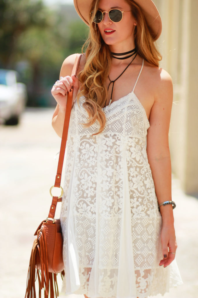 Orlando Florida fashion blog styles Forever 21 lace boho dress, lace up block heel booties, Sancia fringe bag, and round Ray Ban sunglasses for a boho look