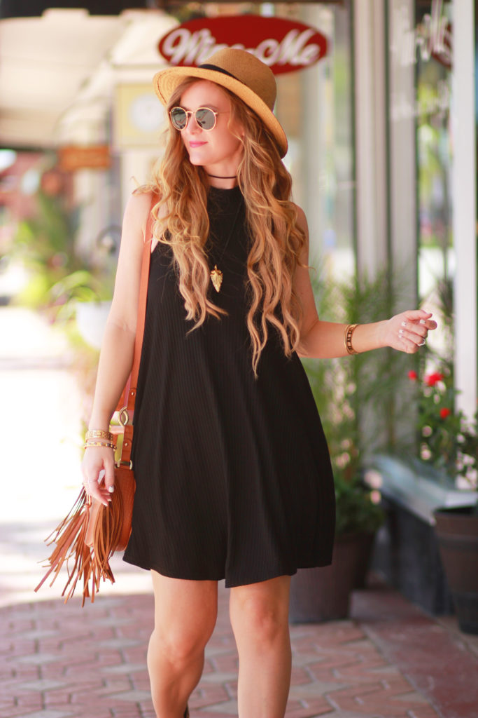 Orlando Florida fashion blog styles Hollister swing dress, Matissa nugent booties, Sancia fringe bag, and Ray Ban sunglasses for a causal spring outfit