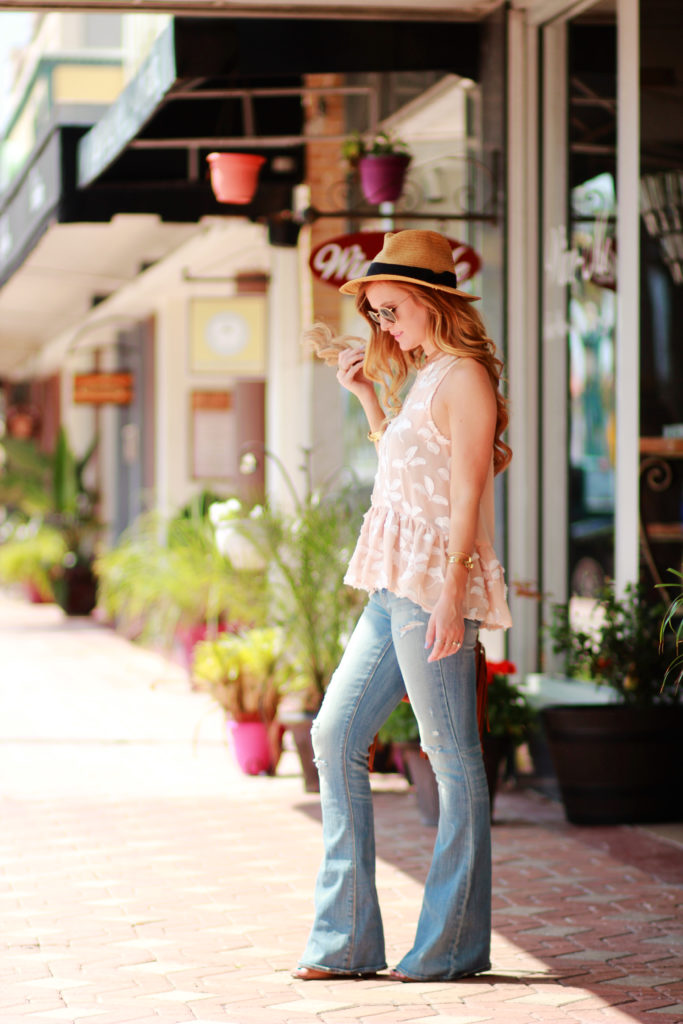 Orlando Florida fashion blog styles Blush and Brulee floral peplum with American Eagle flared jeans, Sancia fringe crossbody for a boho chic spring outfit