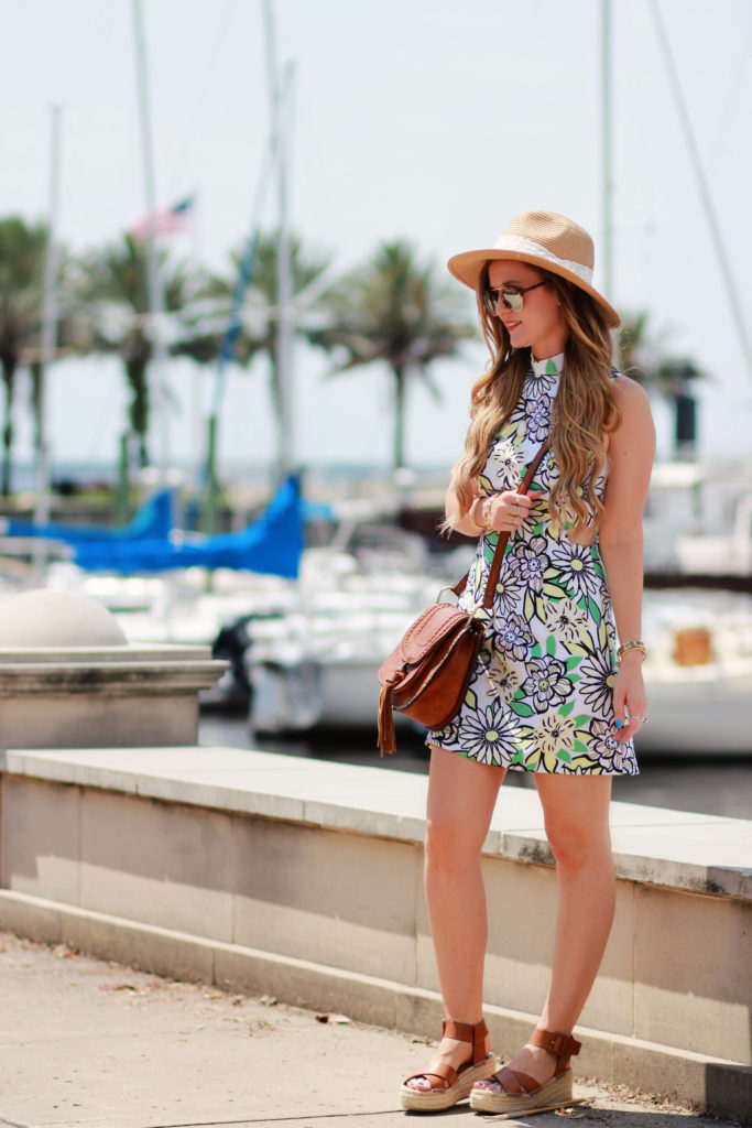 Orlando Florida fashion blog styles H&M floral dress with Windsor tassel bag, espadrille flatforms, Illesteva mirrored sunglasses for a casual summer outfit