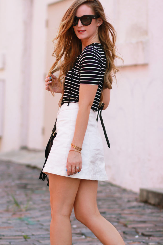 Orlando Florida fashion blog styles stripe lace up top with H&M button up denim skirt, Sole Society fringe bag, and Valley Dead Coffin Club sunglasses