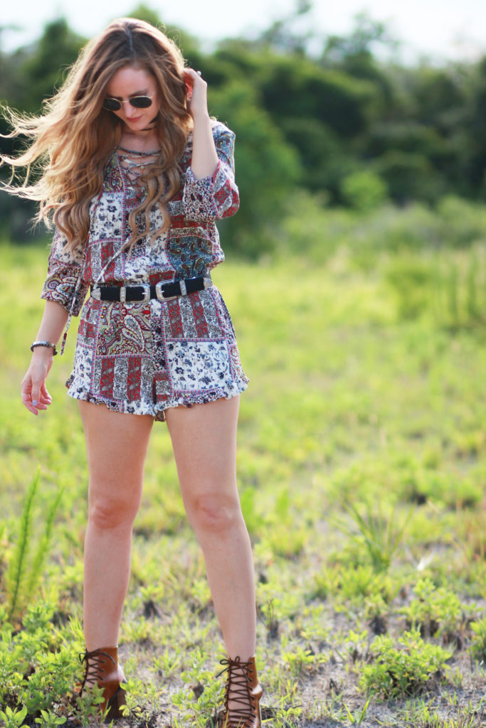 Orlando Florida fashion blog styles American Eagle romper, lace up booties, double buckle belt, and round Ray Ban sunglasses for a summer boho outfit