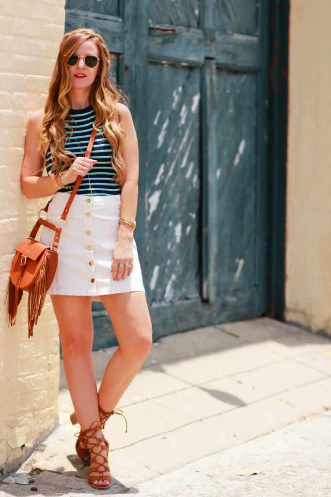 Florida fashion blog styles H&M stripes halter top with H&M cream button up skirt, Dolce Vita lace up heels, and Sancia fringe bag for a summer outfit