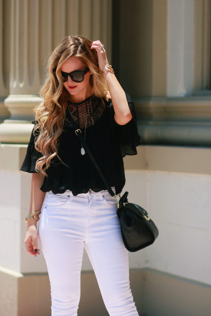 Orlando Florida fashion blog styles black and white date night outfit with Shein off the shoulder top, Forever 21 flare jeans, and Valley Eyewear sunglasses