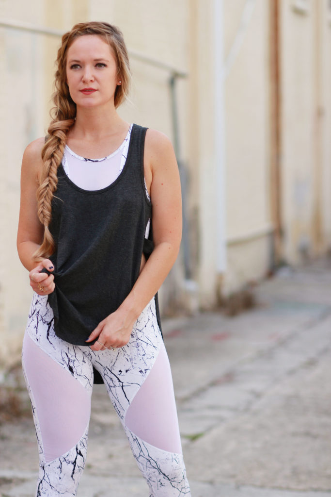 Orlando Florida fashion blog styles Carbon 38 marble print leggings and sports bra with a cut out tank top and Nike Juvenate sneakers, cute fitness outfit