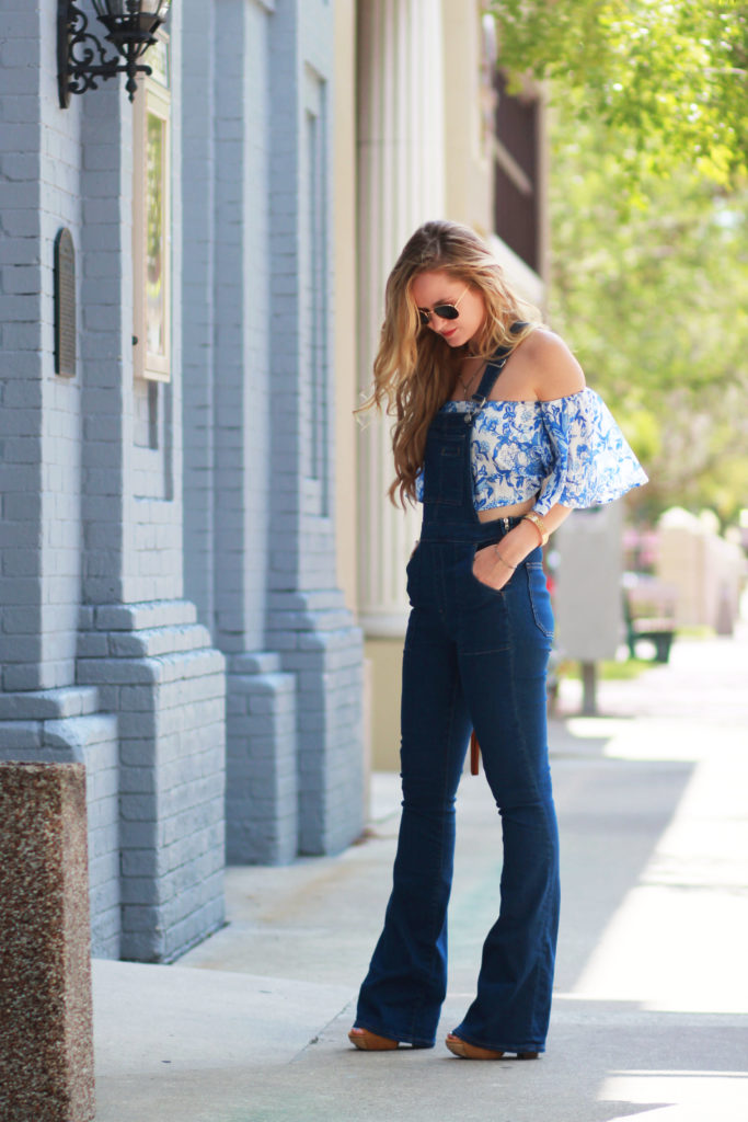 Orlando Florida fashion blog styles Gap flared overalls with Goodnight Macaroon floral crop top and Sancia fringe bag for a bohemian summer outfit