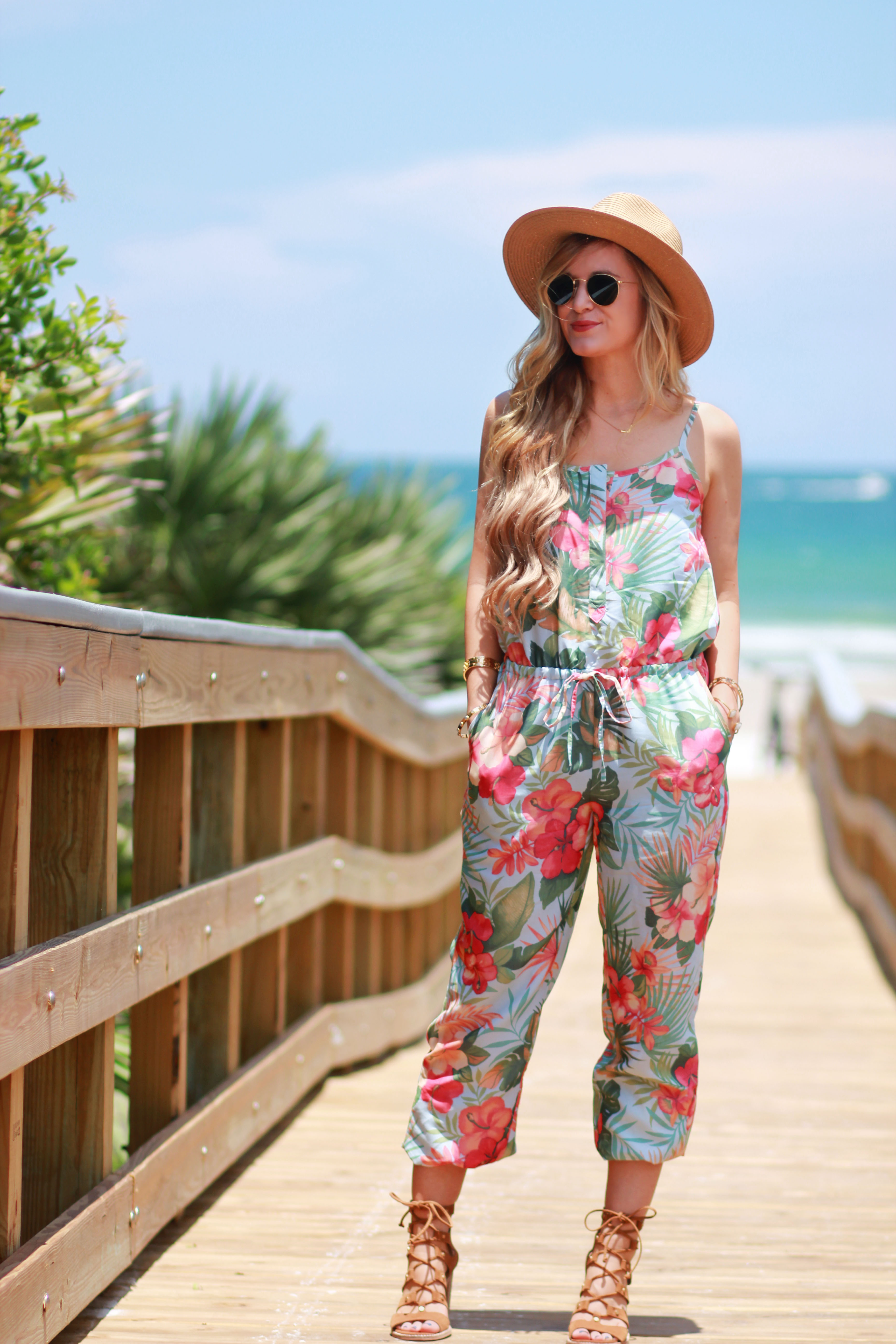 f0ef9199ca3 Orlando Florida fashion blog styles Tommy Bahama tropical jumpsuit with  lace up sandals and round Ray