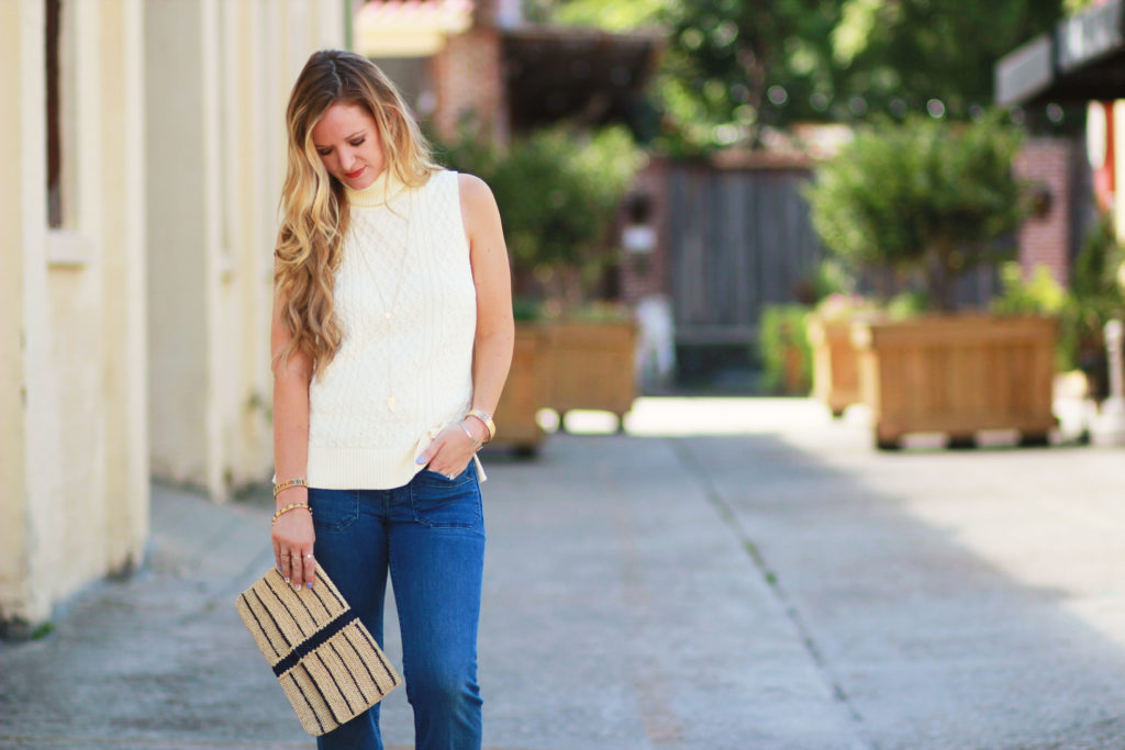 Shannon Jenkins of Upbeat Soles styles a fall transition outfit with Tommy Bahama flared jeans from day to night, turtleneck sweater, and plaid shirt