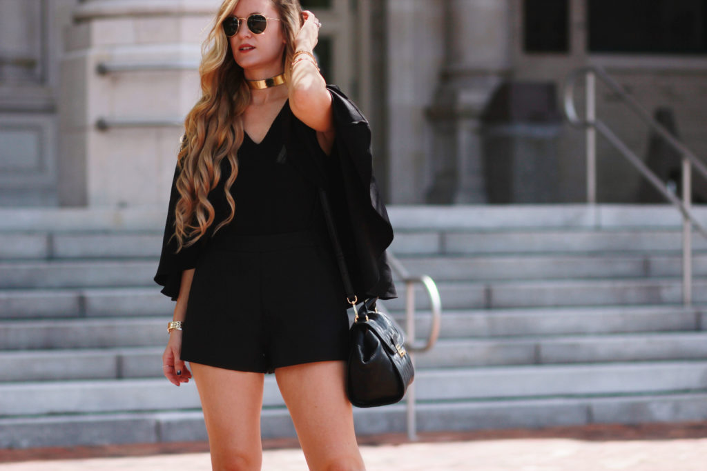 Orlando Florida fashion blog styles Chicwish black cape romper with Kendall and Kylie Evie heels, and Vera Bradley leather bag for a sexy date night outfit