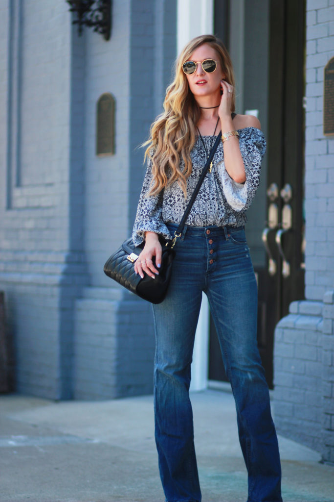 Orlando Florida fashion blog styles Goodnight Macaroon off the shoulder top with Abercrombie flared jeans and Vera Bradley bag for a fall transition outfit
