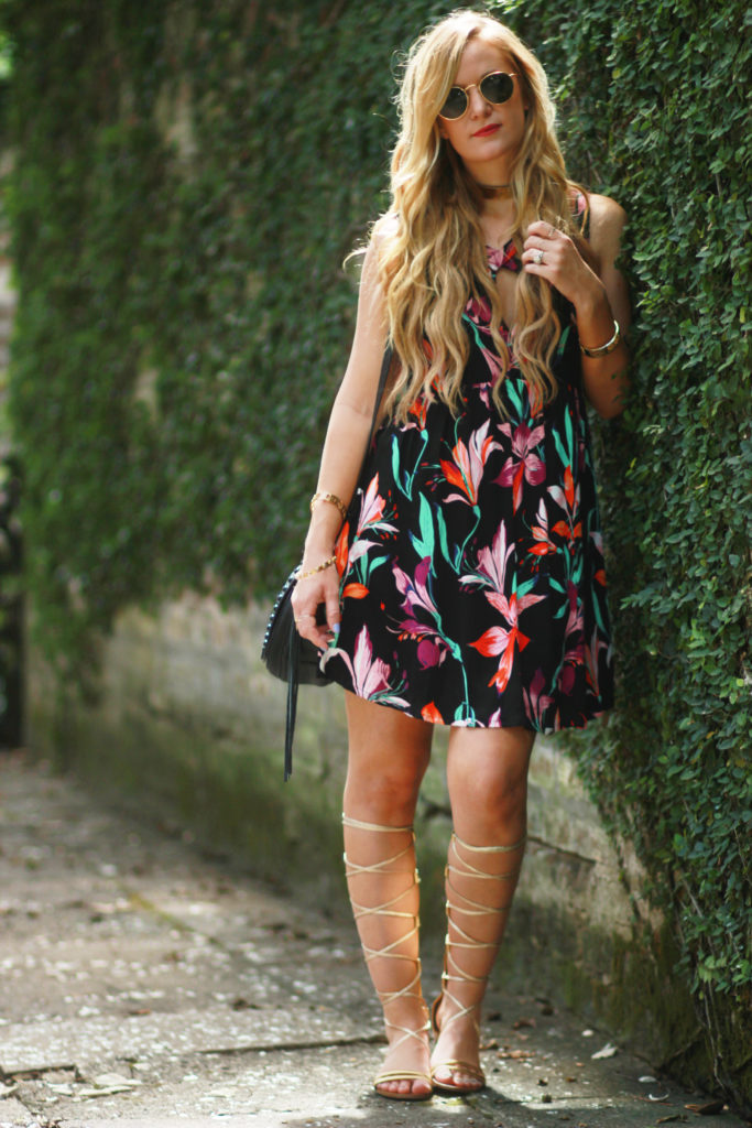 Orlando Florida fashion blog styles Mink Pink floral summer dress with gold gladiator sandals, and Rebecca Minkoff saddle bag for a casual summer outfit