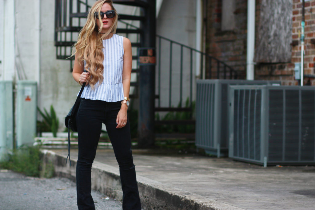 Orlando Florida fashion blog styles striped peplum top with flared black jeans, Valley Eyewear sunglasses, and black saddle bag, Fall transition outfit