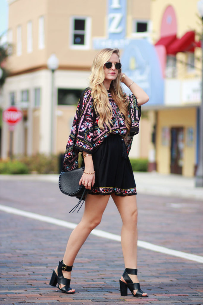 Shannon Jenkins of Upbeat Soles styles a fall transition outfit with Michael Kors jean culottes, mockneck bodysuit, and Vera Bradley leather bag
