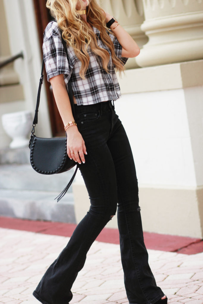 Shannon Jenkins of Upbeat Soles styles a fall transition outfit with plaid cropped blouse, Gap black flared jeans, and Daniel Wellington classic black watch