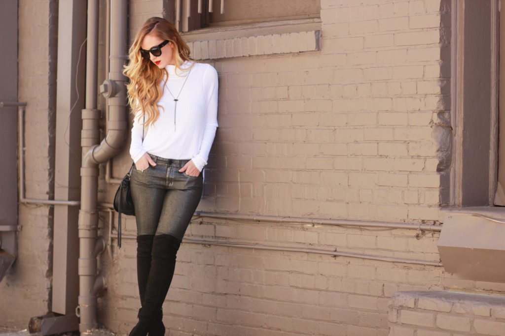 Shannon Jenkins of Upbeat Soles styles a casual holiday outfit with metallic jeans, Free People henley, and Dolce Vita black over the knee boots